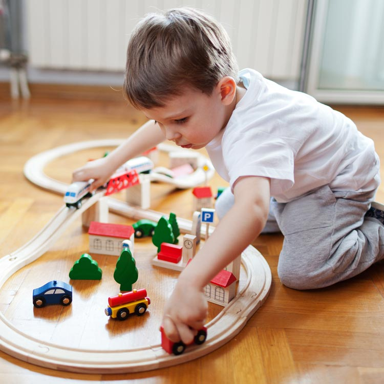 Young Boy Playing with Wooden Toys