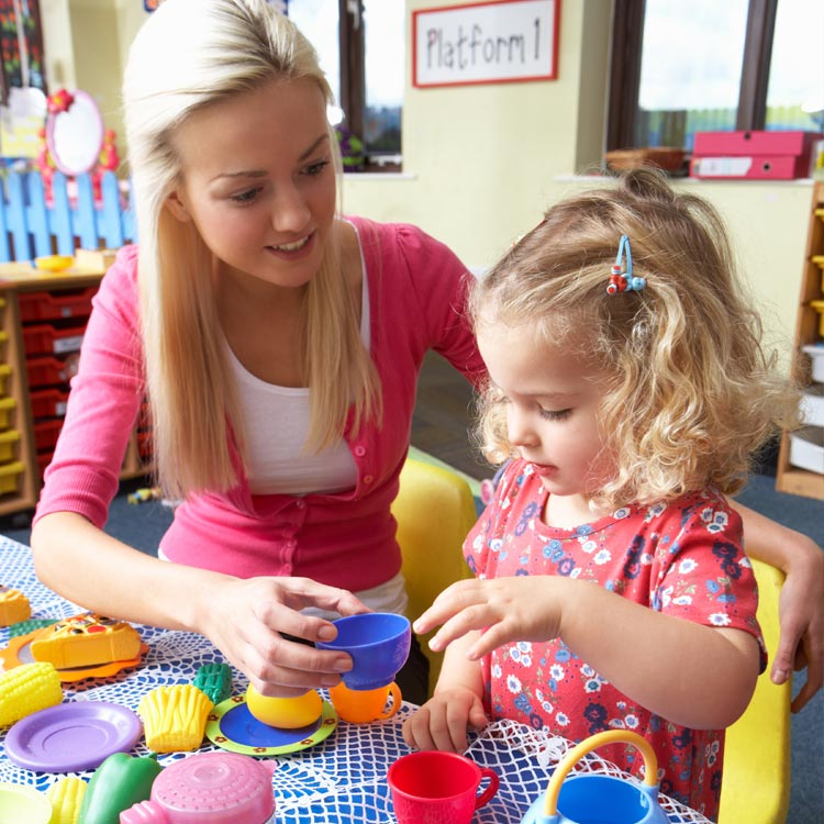 Child Care Worker Playing with a Young Girl