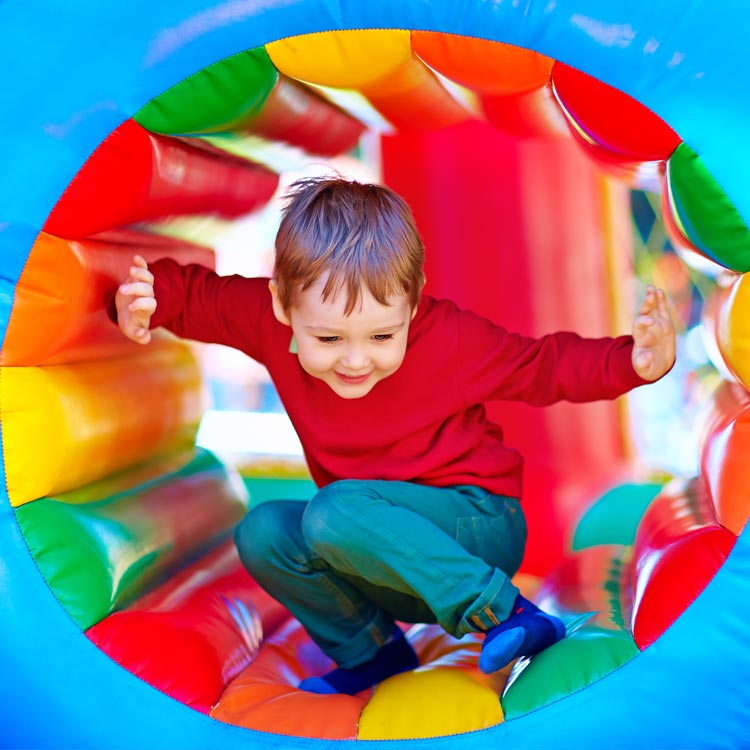 Boy Playing in a Bouncy Castle